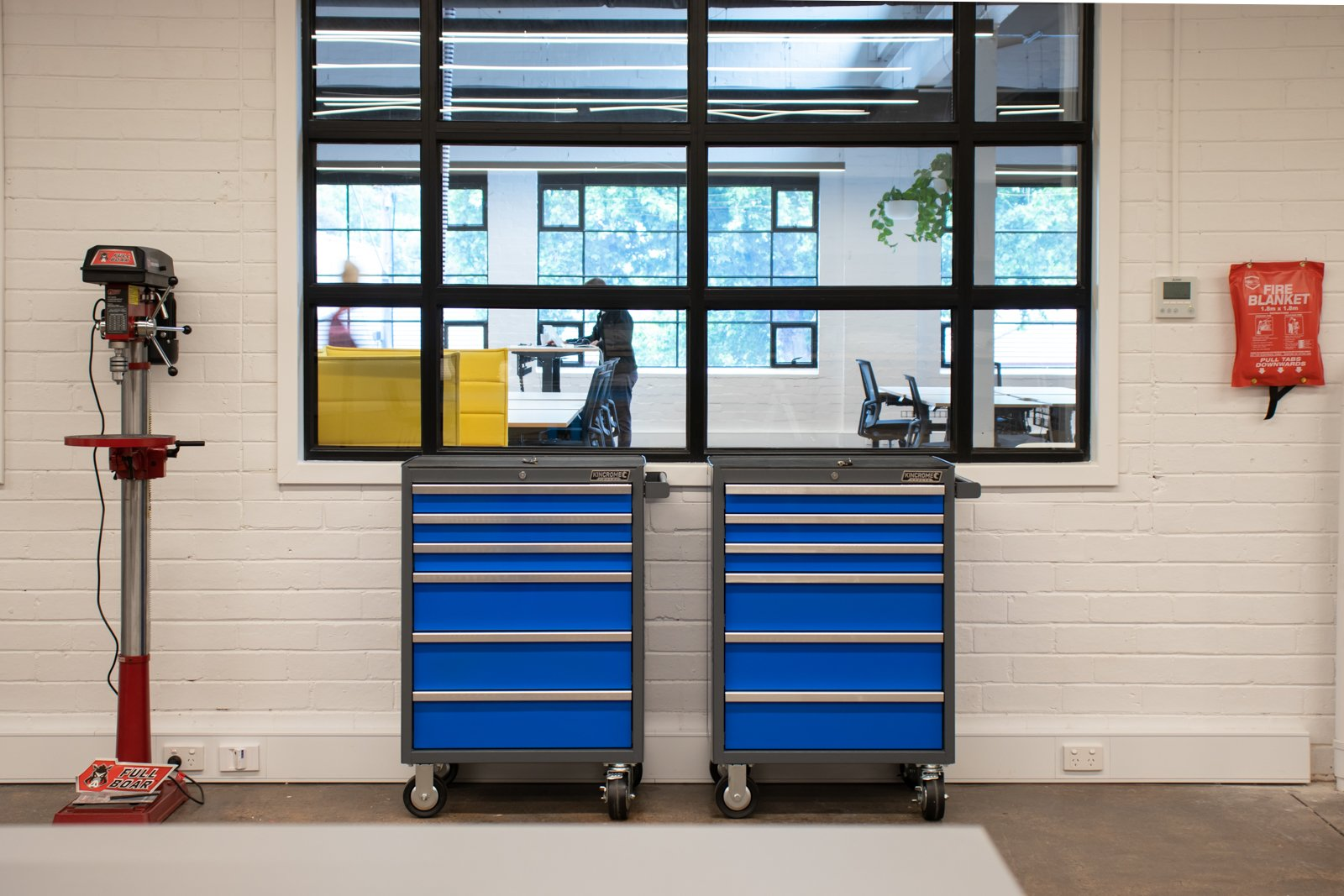 two blue tool boxes and a drill inside Runway's Fabrication Lab